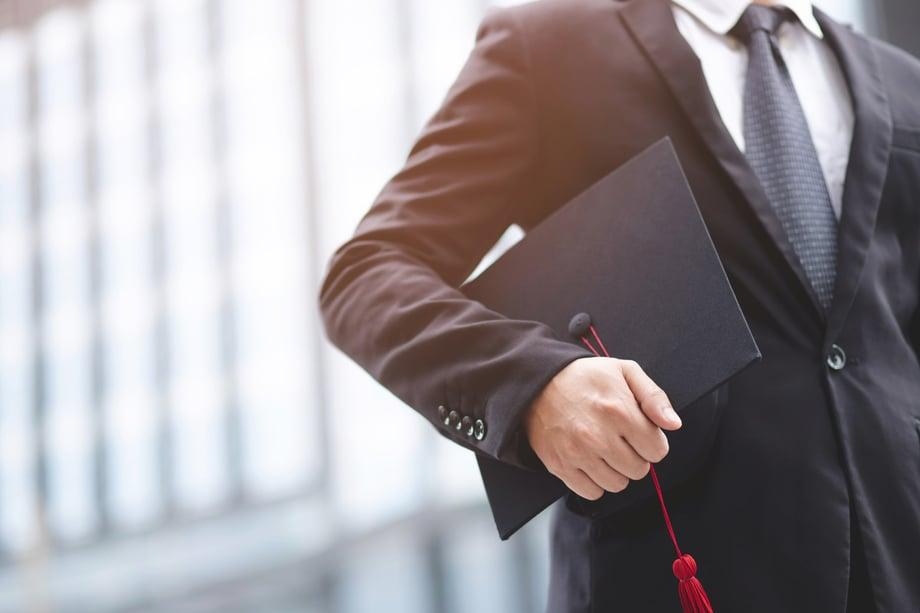 Man-using-graduate-degree-to-climb-the-corporate-ladder