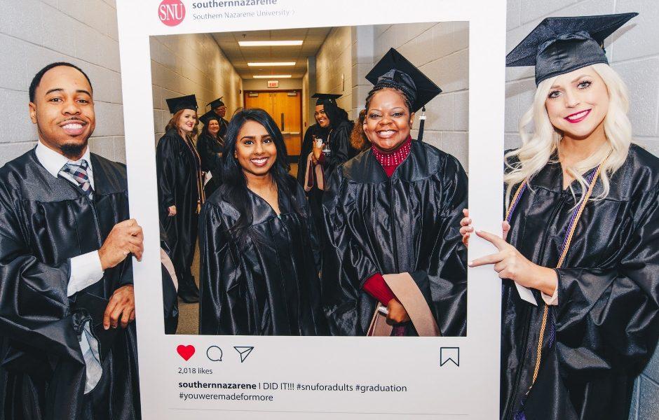 Classmates standing together in graduation regalia