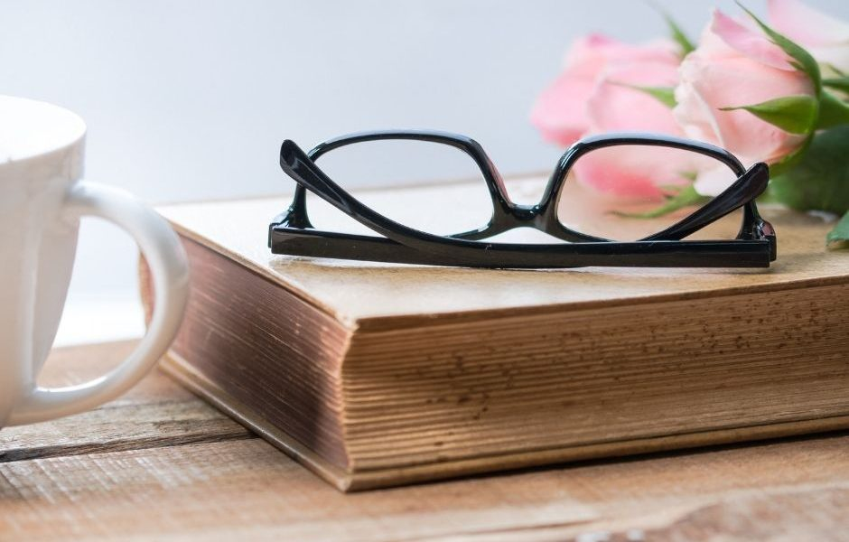 pair of glasses sitting on a book