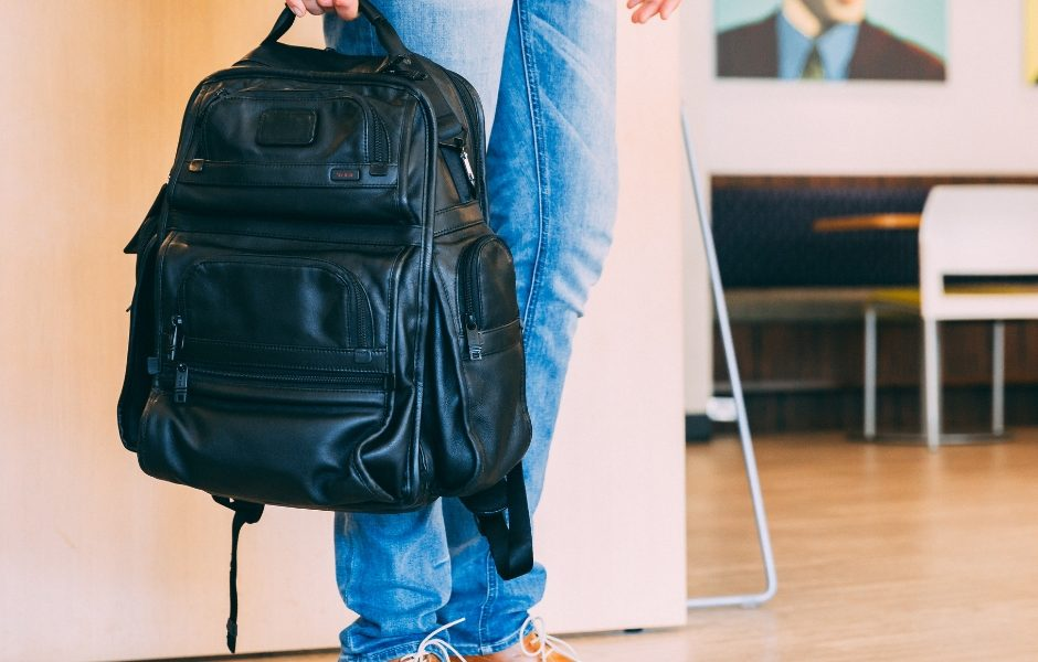 adult standing with backpack