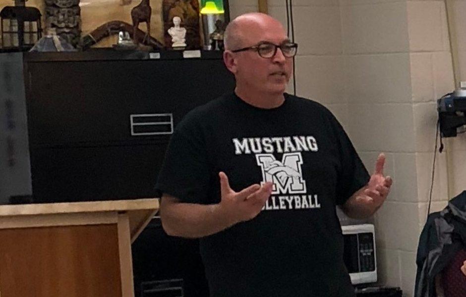 man, standing front of class, teaching