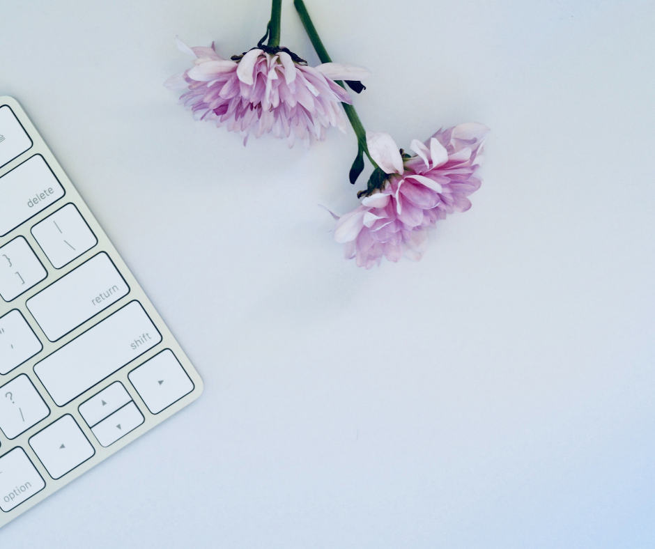 flowers laying next to keyboard