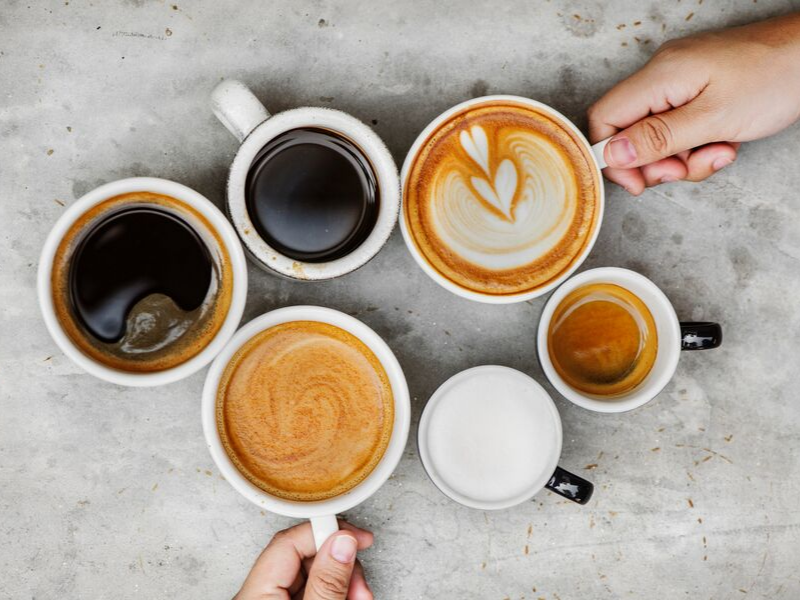 six cups of coffee in varying colors