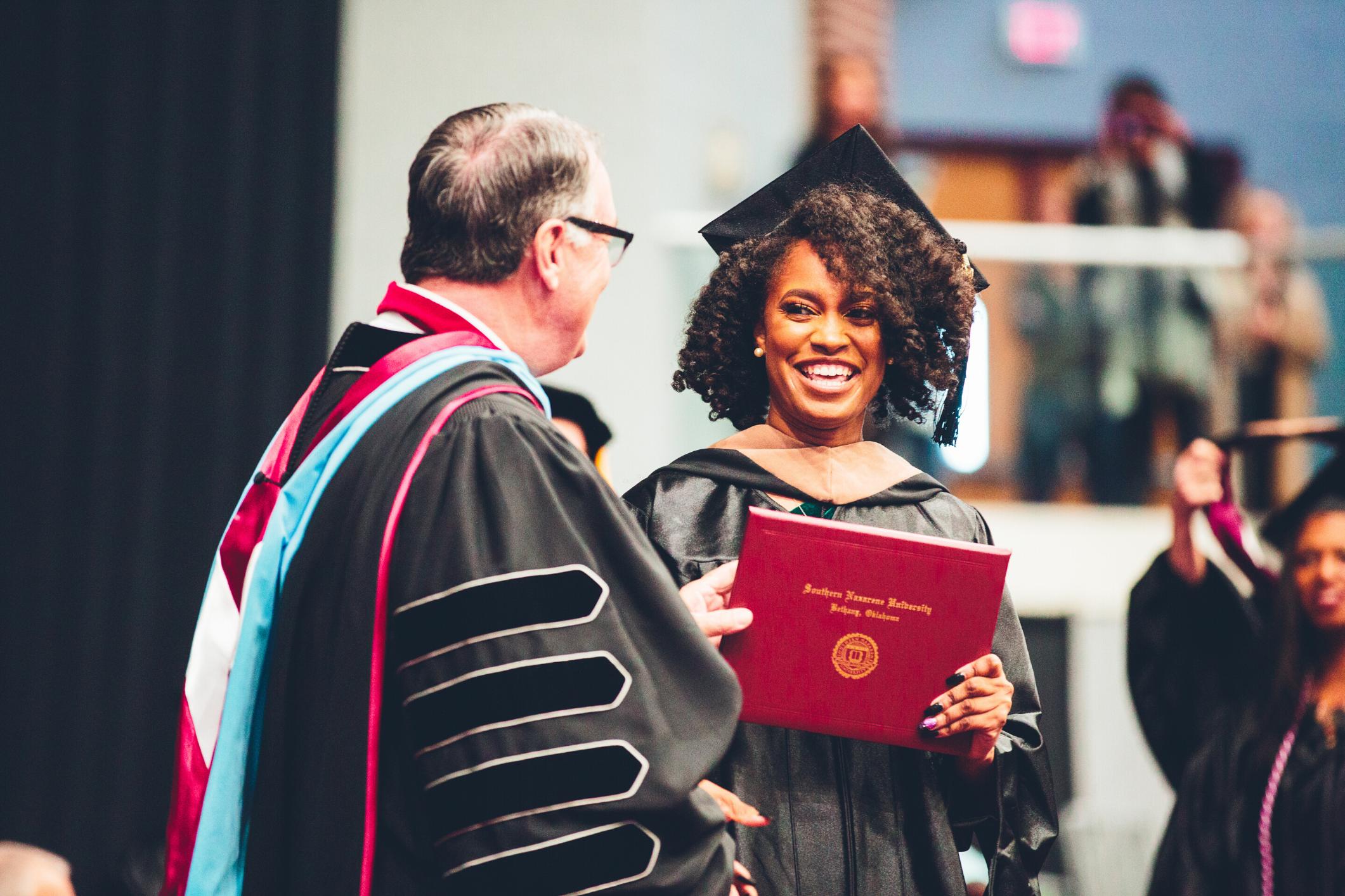 Woman Getting Diploma at Graduation