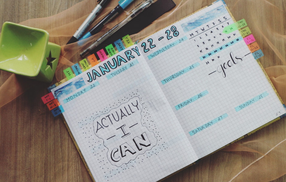 day planner with colorful highlights laying on a table